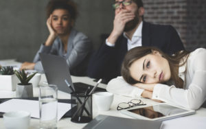 people falling asleep in an office