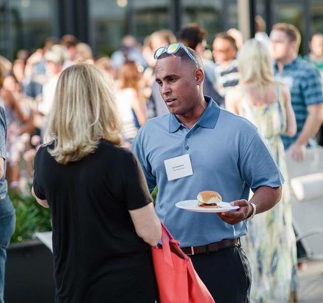2 people talking at a networking event